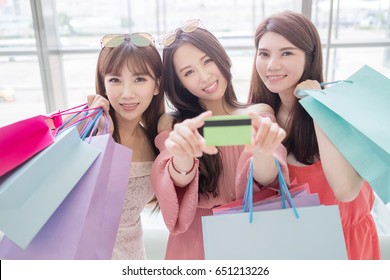 beauty women take credit card and smile happily in mall