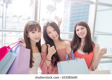 beauty women take shopping bag and thumb up in mall