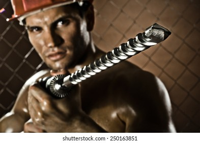 the beauty worker driller man  close up, wield with  perforator
