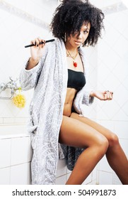 beauty young african american woman in bathrobe with tooth brush