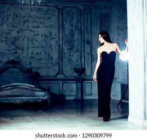 beauty young brunette woman in luxury home interior, fairy bedroom grey stylish bright looking rich
