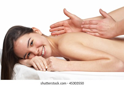 beauty young girl getting a massage at the day spa