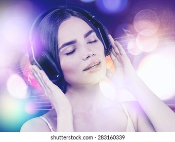 Beauty young girl hearing music with headset, female portrait