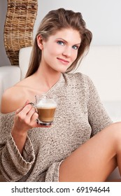 Beauty, young girl holding a cup of coffee and smiling
