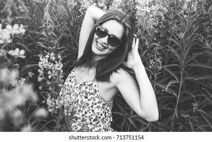 Beauty young girl outdoors enjoying nature. Black and white photo