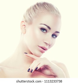 Beauty young model woman face. Girl hold hand near chin. Clean skin, lip contouring, natural nude make-up, blonde hair, blue eyes