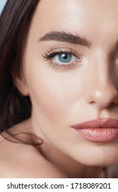 Beauty. Young Woman Close Up Portrait. Blue-Eyed Brunette With Perfect Skin. Beautiful Girl With Natural Daily Makeup.