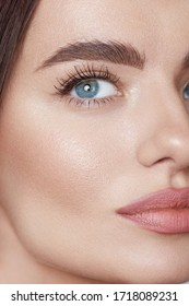 Beauty. Young Woman Close Up Portrait. Beautiful Blue-Eyed Model With Perfect Skin And Natural Daily Makeup Looking Away.