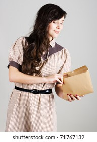 beauty young woman with envelope