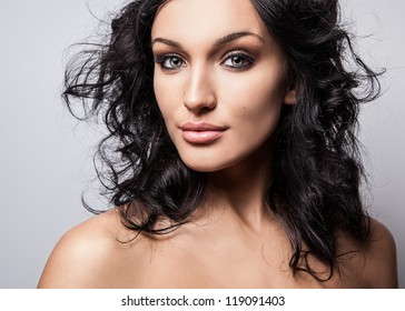 Beauty of a young woman face. Close-up studio portrait.