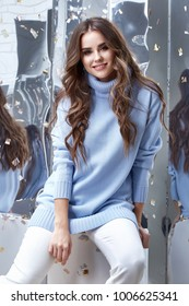 Beauty young woman glamor model businesswoman fashion clothes lady wear casual style for date wool sweater baby blue color white pants pretty face dark natural hair spring autumn collection party fun.