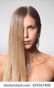 Beauty young woman long hair half face upper body