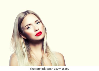 Beauty young woman portrait. Beautiful model girl with beauty makeup, red lips, perfect fresh skin. Attractive lady with blue eyes, blonde hair. Youth and Skin Care Concept. Copy space