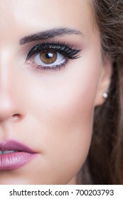beauty young woman portrait with glittering evening makeup closeup studio shot