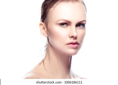 Beauty young woman portrait isolated on white. Beautiful model girl with nude  makeup, natural lips, perfect fresh skin. Attractive Blonde wet hair lady with green eyes. Youth and Skincare Concept