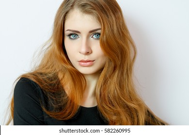 Beauty young woman portrait on white. Beautiful model girl with gentle makeup, pink lips, perfect fresh skin, blue eyes, redhead. Youth and Skin Care Concept.