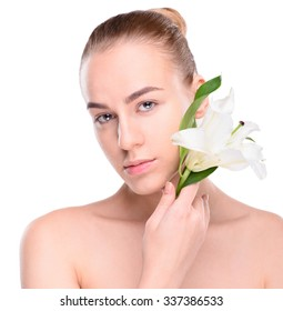 Beauty young woman posing with lily. Isolate on white background