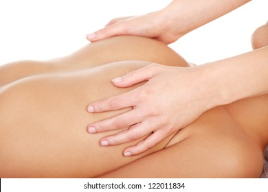 Beauty young woman relaxing in spa. Breast massage.