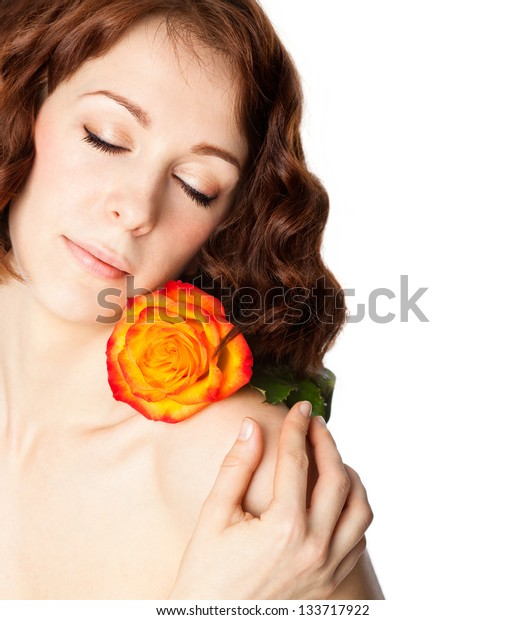 Beauty young woman with rose on white background