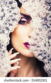 beauty young woman throw white lace close up, bride under veil, real bride brunette sexy