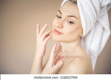 Beauty young woman with towel. Space for copy.