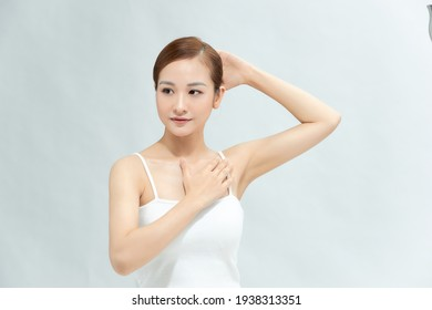 Beauty, youth, freshness and perfect skin. Armpit epilation, laser hair removal. Beautiful woman holding her arms up and showing clean underarms, depilation smooth clear skin in studio.