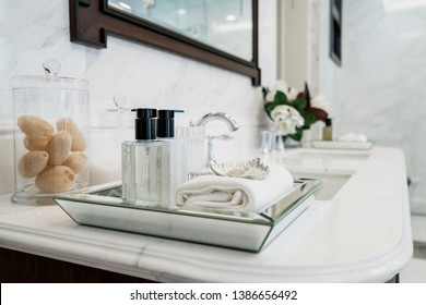 beautyful amenity set in white color clean marble counter bathroom interior design