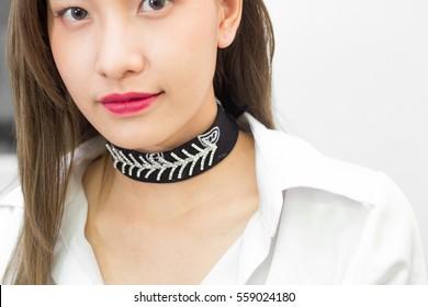 Beautyful asian women with choker necklace.