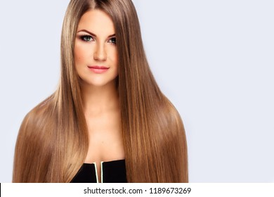 Beautyful blonde girl with straight long hair. Blond healthy hairstyle