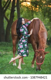 Beautyful blonde woman with horse