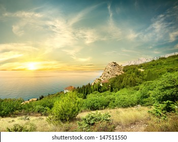 Beautyful sunrise in the Black sea and mountains