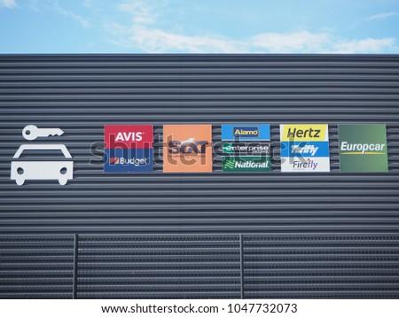 020a7ed72a46 Beauvais, France, March 7, 2018. Rental cars company logos on office facade