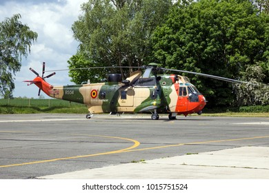 BEAUVECHAIN, BELGIUM - MAY 20, 2015: Belgian Navy Sea King rescue helicopter on the tarmac of Beauvecahin airbase.