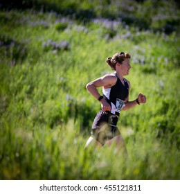 Beaver Creek, Colorado, USA - July 17, 2016: Pro triathlete Sarah Graves runs to a win in the women's race at the XTERRA Beaver Creek 20K Trail Run a day after placing in the top ten at the triathlon.