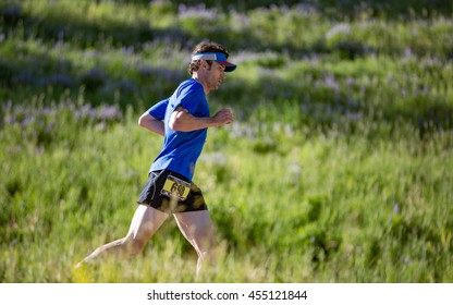Beaver Creek, Colorado, USA - July 17, 2016: Robb Whittier of Denver runs to a fifth place finish in the XTERRA Beaver Creek 10K Trail Run.