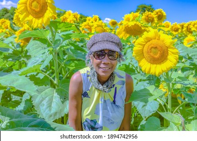Beaverton, Ontario Canada - August 06, 2020: A close up of a black woman in a sunflower field