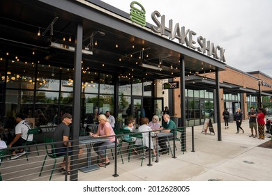 Beaverton, OR, USA - July 7, 2021: Outdoor dining at the Shake Shack restaurant in Beaverton, Oregon, amid the pandemic. Shake Shack is an American fast casual restaurant chain based in New York City.