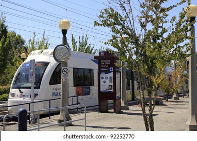 BEAVERTON, OREGON - AUGUST 3: Light rail electric MAX train at the Elmonica station on August 3, 2010 in Beaverton, Oregon. An average of 127,000 people per week day ride the MAX trains.