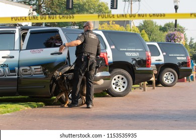 Beaverton, OR / USA - August 7 2018: K9 Police unit parked in a park.