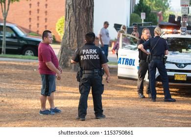 Beaverton, OR / USA - August 7 2018: Park patrol officer at community event.