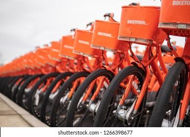Beaverton, OR / USA - December 24 2018: Rows of Biketown Nike ride sharing bikes parked outside.