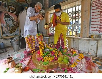 Beawar, India, July 6, 2020: Hindu devotees perform 'Abhishek' of Lord Shiva on the first Somwar (Monday) of the holy month of Shravan or Sawan at Mahadev temple in Beawar. Photo: Sumit Saraswat