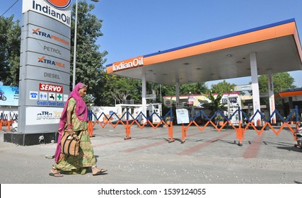 BEAWAR, INDIA, OCTOBER 23, 2019 : A woman walks fast a closed petrol pump during petrol pump strike called by Rajasthan Pump Dealers Association against VAT rate in Beawar. Photo/Sumit Saraswat