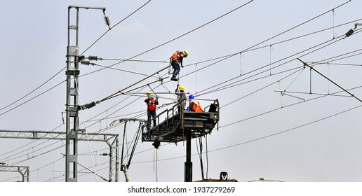 Beawar, Rajasthan, India, March 16, 2021: Workers test electric wires on the Delhi-Mumbai railway corridor, in Beawar. Photo: Sumit Saraswat