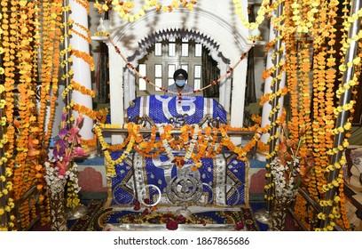 Beawar, Rajasthan, India, Nov. 30, 2020: Sikh priest sits behind the Guru Granth Sahib (Sikh holy book) at Gurudwara on the occasion of Guru Nanak Dev Jayanti, in Beawar. Photo: Sumit Saraswat