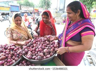 Beawar, Rajasthan, India, September 30, 2019 : Indian women buys red onions in indian market. Photo/Sumit Saraswat