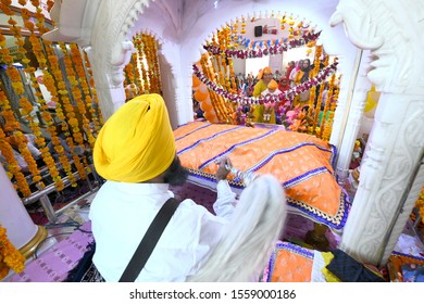 Beawar, Rajasthan - November 12, 2019: Sikh Devotees pay obeisance at a holy Gurudwara on the occasion of birth anniversary of Sikh Guru Nanak Dev Ji at Beawar, Rajasthan, India. Photo/Sumit Saraswat