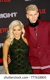 "Bebe Rexha and Machine Gun Kelly attend the Netflix ""Bright"" premiere on Dec. 13, 2017 at the Regency Village Theatre in Los Angeles, CA."