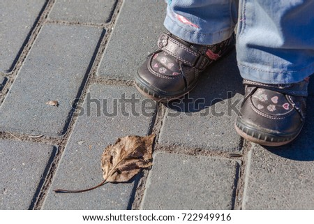 bebys feet cute shoes on paving stock photo edit now 722949916