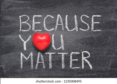 because you matter phrase handwritten on chalkboard with red heart symbol instead of O